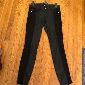 Black jeans with lace trim on the legs.